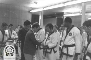 Hwang Kee promoting Chuck Norris and Pat Johnson in 1970, standing next to Master Ahn